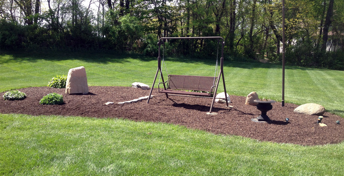 Yard with swing and mulch landscaping